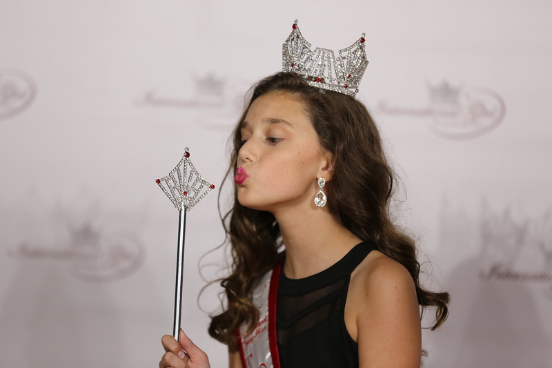 Girl in Tiara Posing with Wand